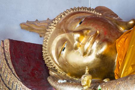a head of a reclining buddha staue in Northern Thailand Stock Photo