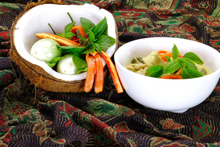 favorite soup: Ingredients for making famous Thai Green Curry with Chicken dish include, red and green chilli, holy basil leaves, kaffir lime leaves, turkey berry, and eggplant
