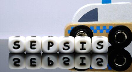 alphabet letters spelling a word sepsis a condition demands urgent medical treatment