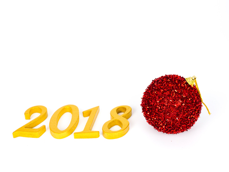gold numbers 2018 for auspicious new year with a red decorative ball, isolated on a white background