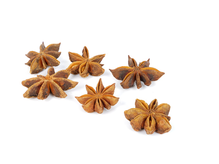 six brown star anises, isolated on white background