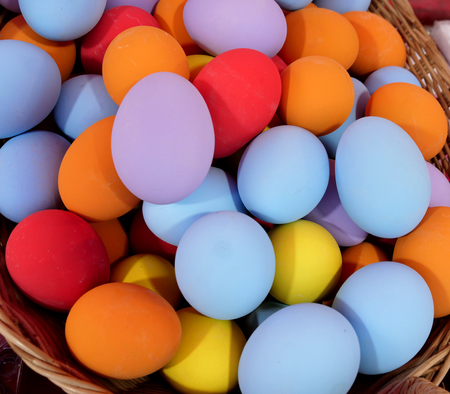 Preserved duck eggs in non-traditional multicolor of blue, orange, red, lilac, and yellow