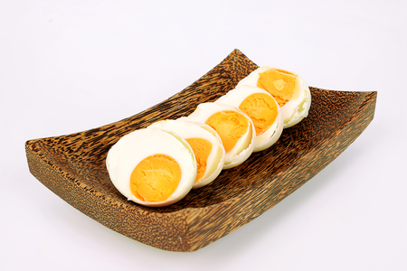 Salted duck eggs on a palm wood tray 스톡 콘텐츠