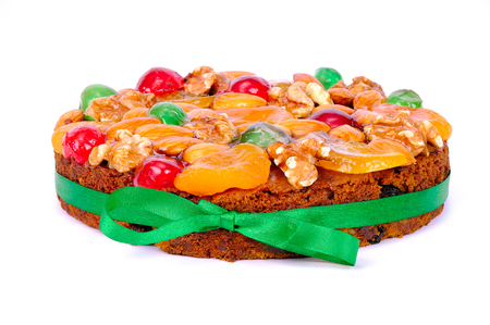 Christmas and New Year fruit cake, isolated on white background Stock Photo