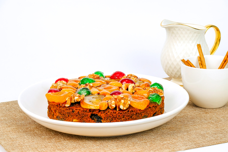 Christmas and New Year fruit cake, on white background,