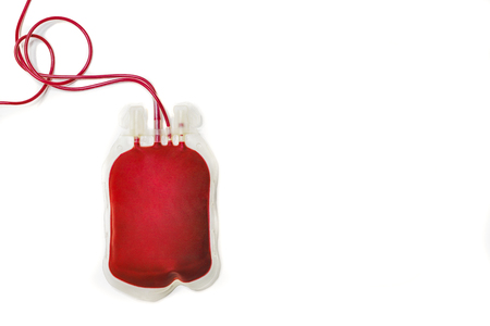 A plastic bag filled with fresh red blood, isolated on white background. Blood donation, transfusion, letting. Top view image with copy space. Archivio Fotografico