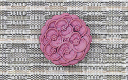 Purple japanese yam moon cake, top view, light brown background Banco de Imagens