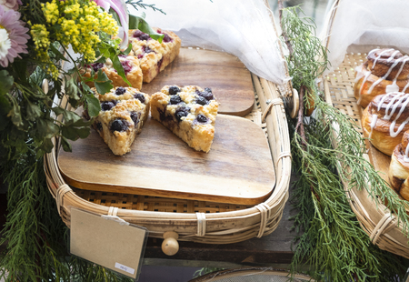 Blueberry and cranberry scones on bamboo baskets.