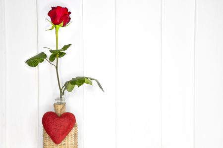 A Single Beautiful Red Rose In A Bamboo Vase White Painted