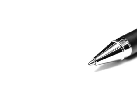 A closeup of a ball point pen in black and white.