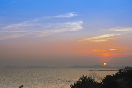 A beautiful display of light in the sky just before sunsetting over Pala beach in Eastern Thailand.   写真素材