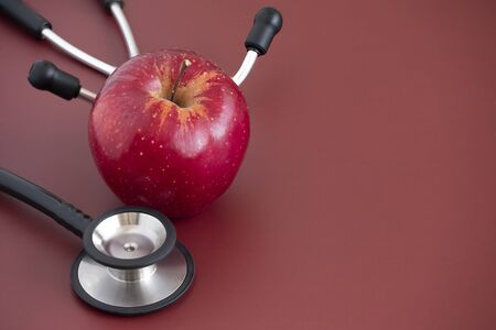 Closeup of a red  apple with stethoscope 写真素材