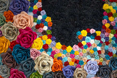 Wall covers with multi colors paper origami roses.
