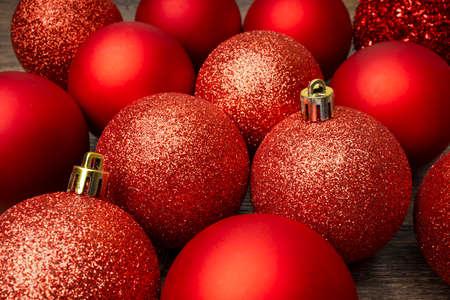 Red Christmas ornamental baubles closeup.
