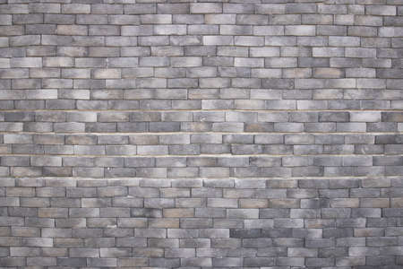 Rough grey brick wall surface texture background.