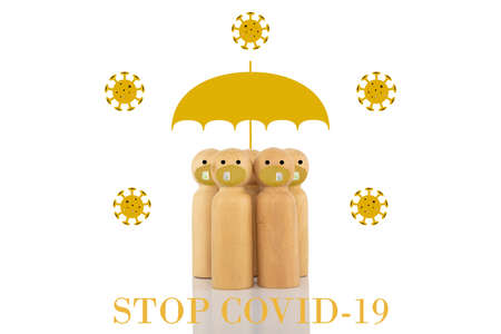 A group of wooden models with face masks and a large gold umbrella surrounded by 2d illustrations of viruses with a text banner reading STOP COVID-19.