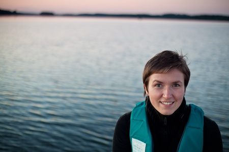 emergency vest: Smiling Young woman in life jacket on the lake