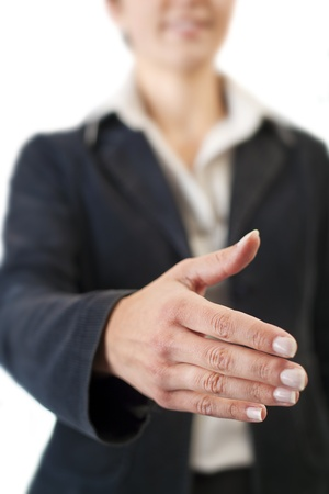 Businesswoman going to shake your hand Stock Photo