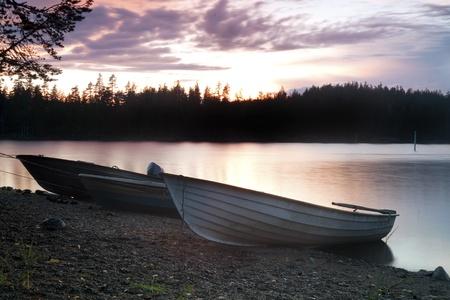 scandinavian peninsula: Three Fishing boat on the shore at evening