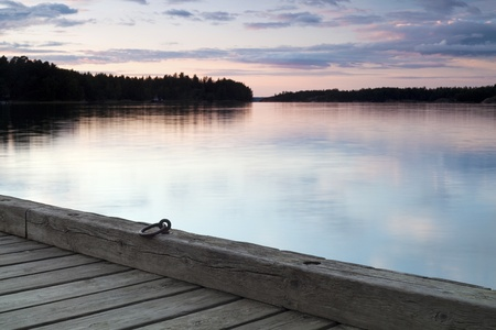Wooden jetty over calm lake just after sunset Stock Photo - 10850870
