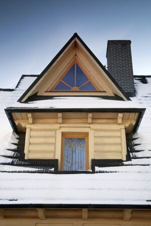 Wooden dormer during winter time Stock Photo - 10938431