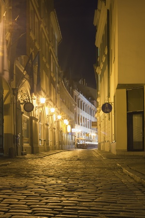 A narrow street in old town of Riga, Latvia Stock Photo - 11012292