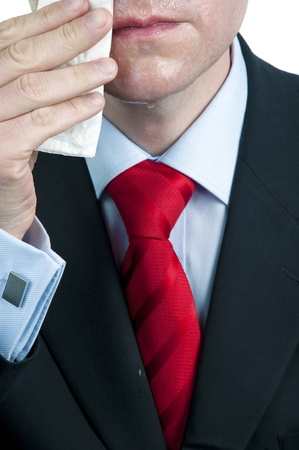 Close - up of Sweaty Businessman Wiping Face Stock Photo
