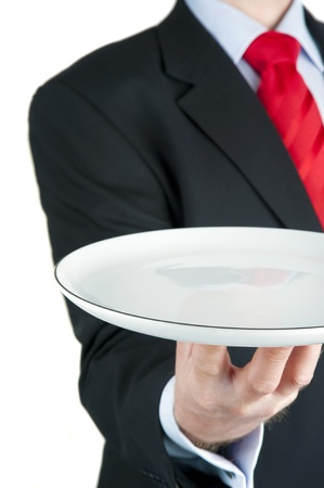 Businessman holding empty plate isolated on white photo
