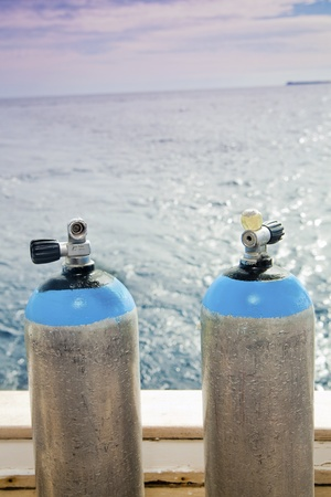 Steel scuba tanks on the dive boat photo