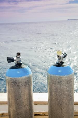 Steel scuba tanks on the dive boat photo