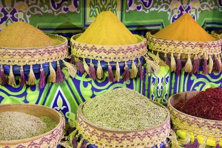 Heap of colorful, powdered spices in african boxes photo