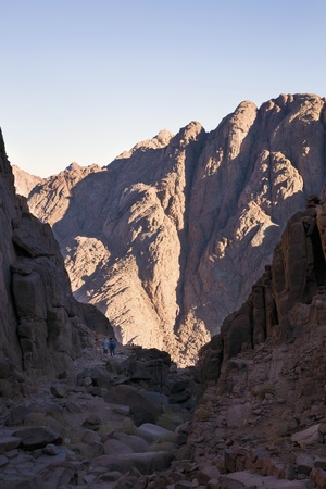 Tourists or light and dark side of Sinai Mountains  Stock Photo