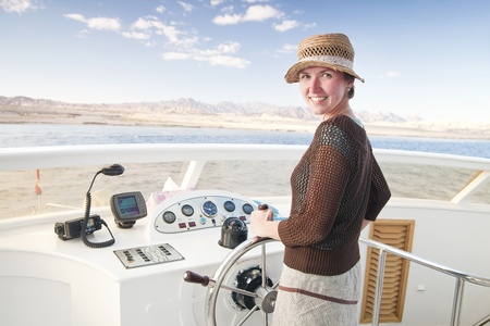 Steering a boat in National Park, Sinai, Egypt