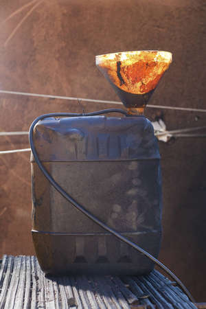 electricity supply: Funnel and canister used for electricity supply