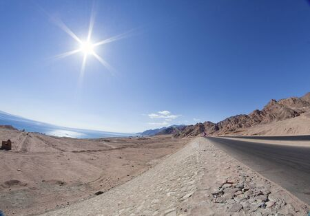 Sinai Landscape  road between sea and mountains Stock Photo - 12658541