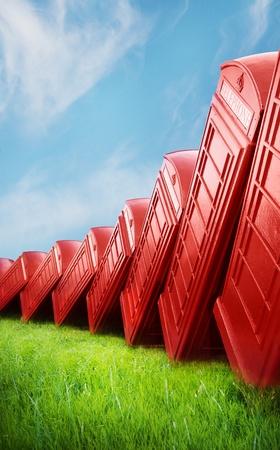 Falling down of British Telephone Box photo
