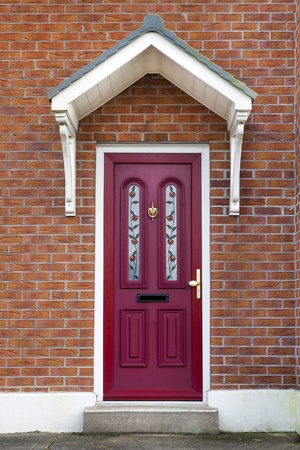 Red door to brick British or Irish House Stock Photo - 12897733