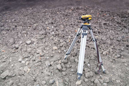 tripod mounted: Land-surveying instrument mounted on tripod