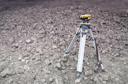 tripod mounted: Land-surveying instrument mounted on tripod