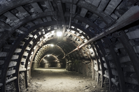 Illuminated, Underground Tunnel in the Minery Фото со стока
