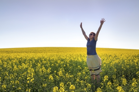 Happy Woman and Canola Field photo