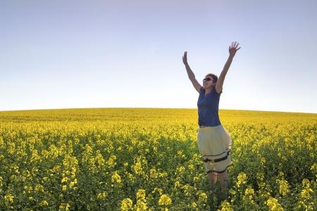 Happy Woman and Canola Field Stock Photo - 13703876