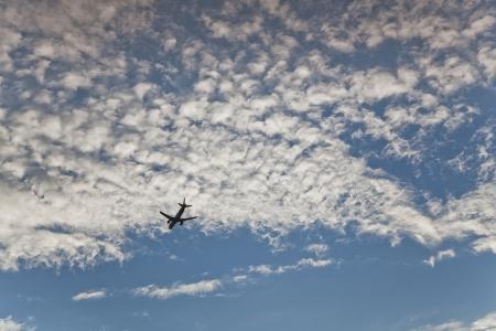 flight mode: Shape of plane on summer sky Stock Photo