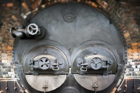 tilt: Heating stove in old factory  tilt lens  Stock Photo