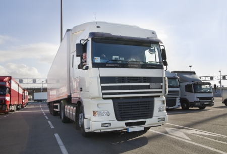 Truck driver and his truck - waiting for a ferry
