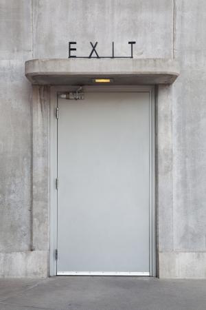 Exit door in concrete wall