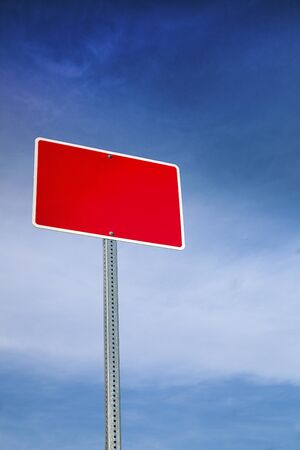 Red Road Sign and Blue Sky Behind Stock Photo - 16263141