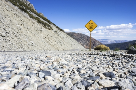 Rock Slide Area Sign Placed in Mountain LAndscape photo