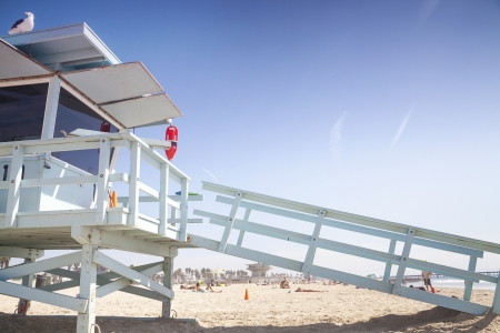 Lifeguard station and tanning and resting people behind, Venice Beach, Santa Monica