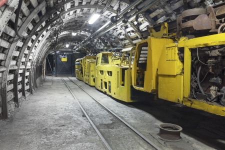 Yellow coal mine transporter Stock Photo